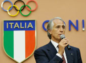 International Olympic Committee President Thomas Bach and the Italian Olympic Committee (CONI) President Giovanni Malago', attend a press conference for Italian Olympic Committee-CONI's 100th anniversary in Rome, Monday, June 9, 2014. (AP Photo/Gregorio Borgia)